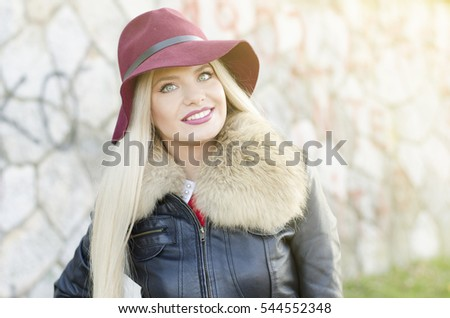 Girl portrait with maroon floppy hat