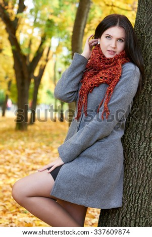 girl portrait with red scarf in autumn city park, fall season - stock photo