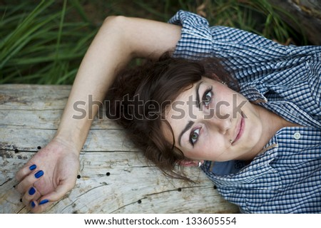 girl posing in a man's shirt in the woods