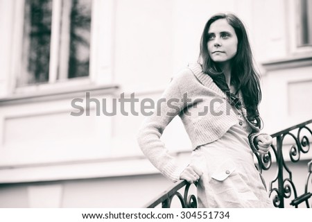 Girl posing on a stairs - stock photo