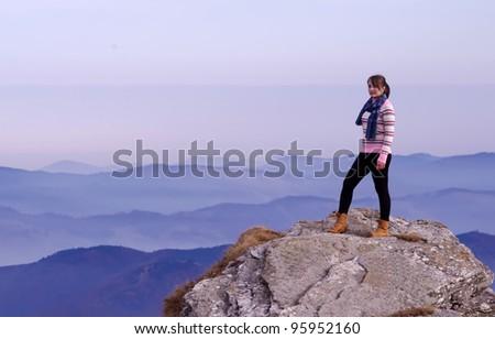 girl posing on mountain landscape - stock photo