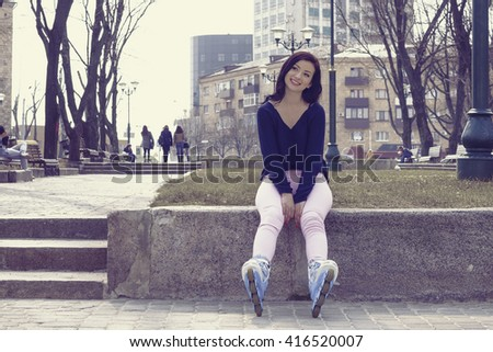 Girl posing wearing a roller skates. Digital photography in vintage style. Concept: lifestyle, sports, entertainment.