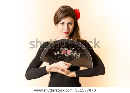 Girl posing with a  fan