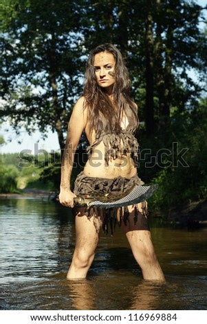 girl posing with a loincloth on the nature - stock photo