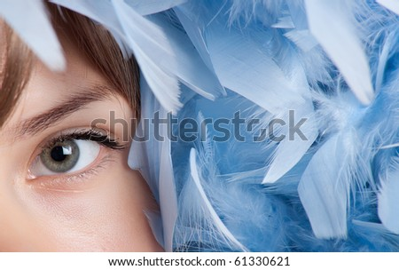 Girl posing with blue feathers - stock photo