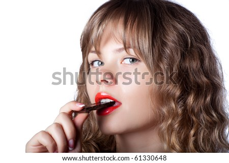 Girl posing with chocolate in hand - stock photo