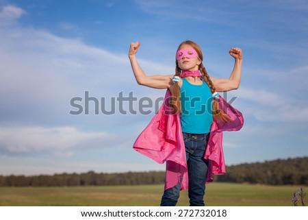 girl power super hero confidence in kids or children - stock photo