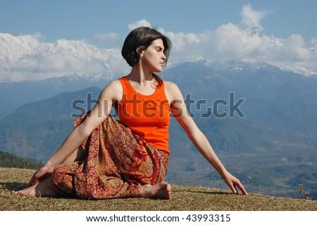 Girl practicing yoga in Himalayas. - stock photo