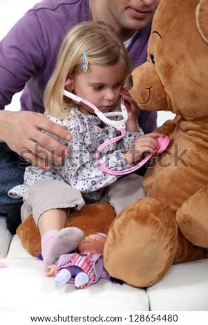 Girl pretending to be doctor - stock photo