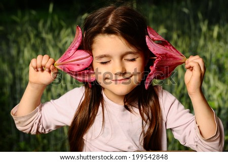 Girl put your ear lily flower (Nature Sounds) - stock photo