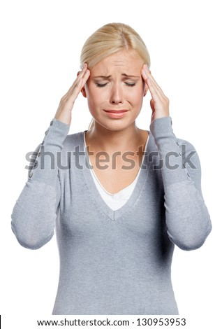 Girl puts hands on the head, isolated on white. Concept of problems and headache