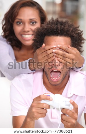 Girl putting hands over eyes - stock photo