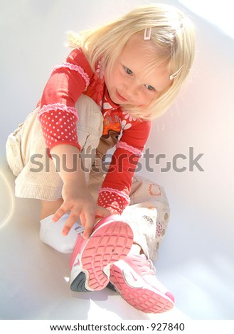Girl putting shoes on (image contains some noise)