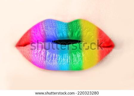 Girl rainbow lips close up - stock photo