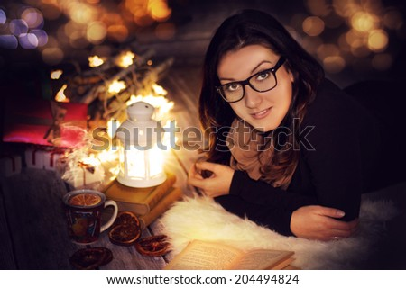 girl reading a book at home on christmas - stock photo