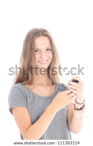 Girl reading a text message Happy smiling young girl reading a text message on her mobile phone isolated on white