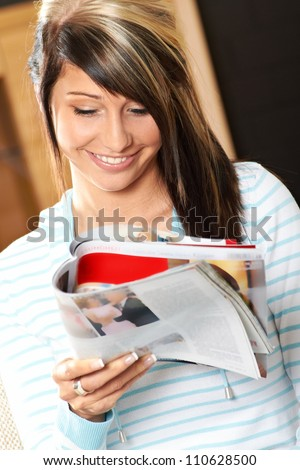 girl reading at home - stock photo