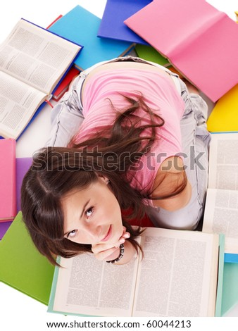 Girl reading open pile book.