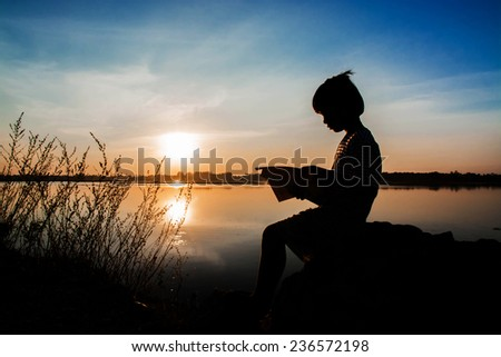 girl reading,silhouette concept - stock photo