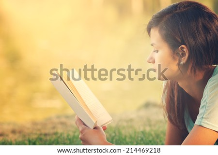 Girl reading the book - stock photo
