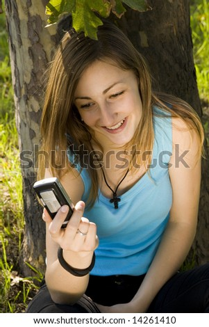 Girl reading the text message on her cellphone