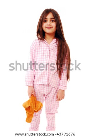 Girl ready for bed isolated on white