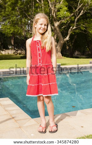 Girl Red Dress Pool Young girl stands casual happy red dress blue pool home vertical photo.