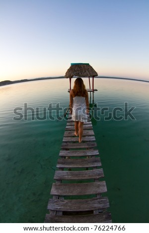 Girl reflecting at a tranquil lake