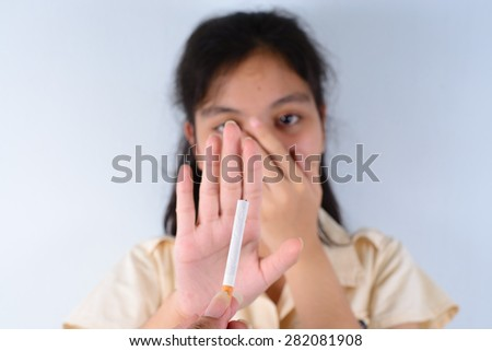 Girl refusing a cigarette of smokes concept for quitting smoking and healthy lifestyle - stock photo