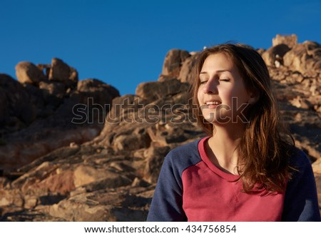 Girl relaxating in mountains - stock photo