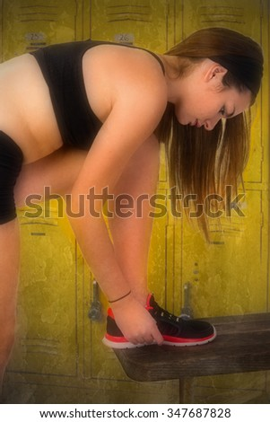 Girl relaxing and getting ready for workout - stock photo