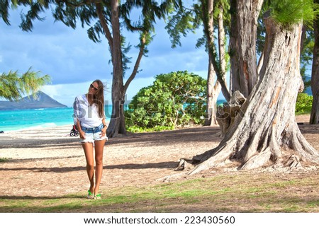 Girl relaxing at luxury travel resort, holidays on Waimanalo Beach Park on the beautiful Hawaiian Island of Oahu  - stock photo