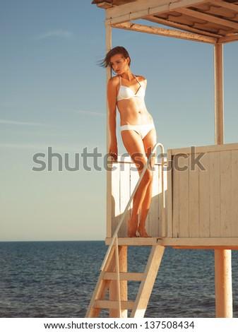 Girl relaxing in a beach gazebo - stock photo