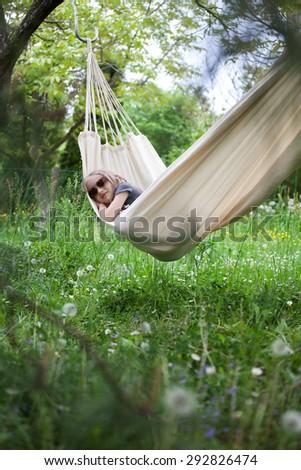 Girl relaxing in hammock - stock photo