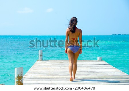 Girl relaxing on Jetty  - stock photo
