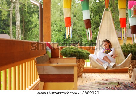 Girl relaxing on the porch - stock photo