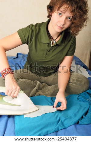 Girl removing vax candle stains with iron and tracing paper