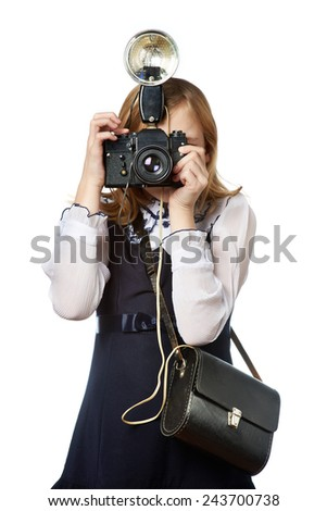 Girl reporter photographer with retro camera and flash isolated - stock photo