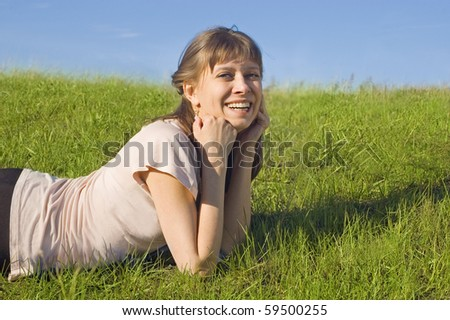 Girl resting on the grass, summer - stock photo