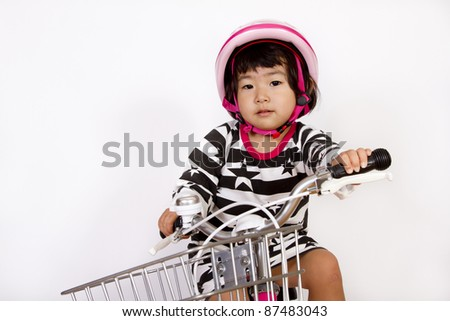 girl rides a bicycle - stock photo