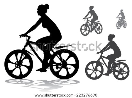 girl rides a bicycle on a walk - stock photo