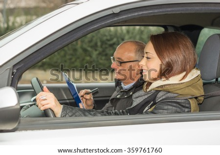 Girl rides during his driving test - caucasian people - Lifestyle and driving school concept - stock photo
