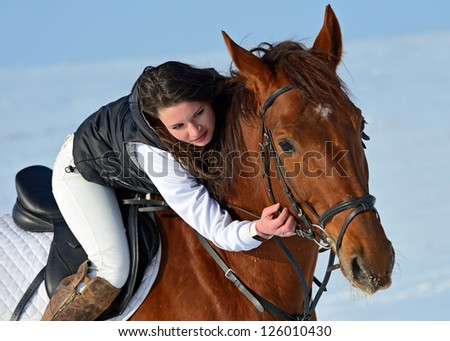 girl riding a horse in winter