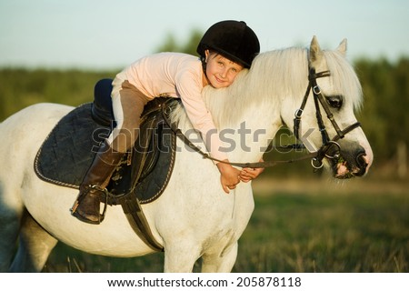 Girl riding a horse on nature - stock photo