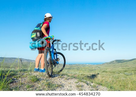 Girl riding on the bike in the Crimea.
