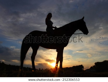 Girl riding saddlebred horse in sunset