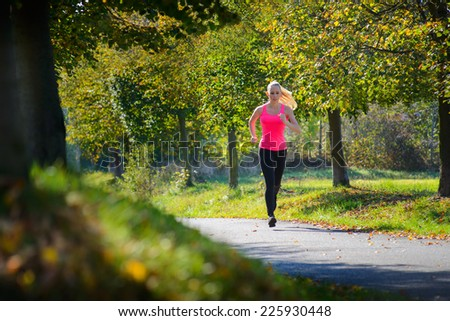 Girl running at sunny day - stock photo