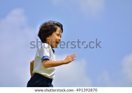 Girl running in the blue sky (Sports day gym clothes)