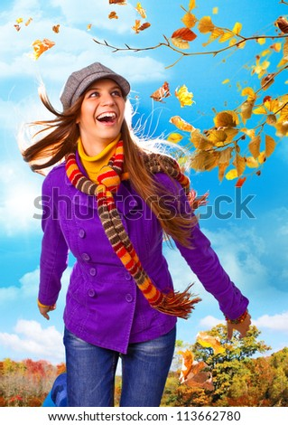 girl running on a meadow in autumn - stock photo