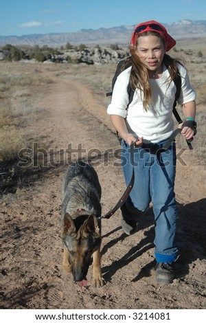 Girl running with dog - stock photo